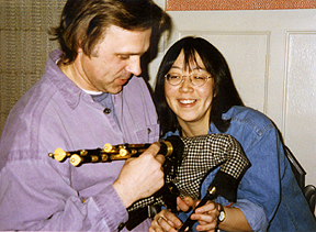 Al shows a cute chick how to play his pipes...