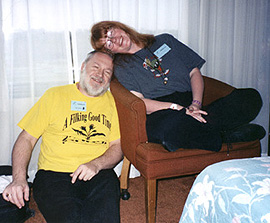Allison and Dave rub heads during a filk convention get-together
